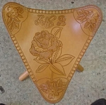 carved leather stool