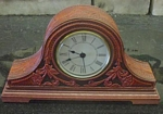 carved leather mantle clock