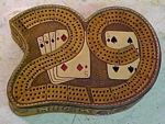 leather crbbage board, carved 29 cribbage board