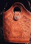 carved leather purse with horse and floral design